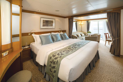 seven-seas-voyager-Deluxe-Suite.jpg - At 356 total square feet, the Deluxe Veranda Suite on Seven Seas Voyager features a marble bathroom, private balcony and sitting area.