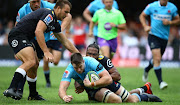 Lukhanyo Am of the Cell C Sharks tackles Jed Holloway of the Waratahs during the Super Rugby match at Kings Park on March 03, 2018 in Durban, South Africa.