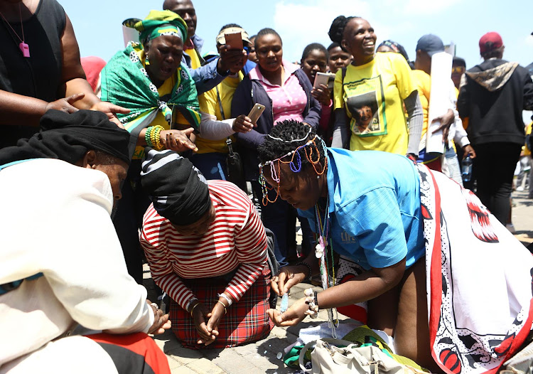 A traditional healer performs a ritual before hundred of ANC members from greater Johannesburg marched to the offices of Mayor Herman Mashaba and Eskom to handover a memorandum demanding service delivery on October 5 2018