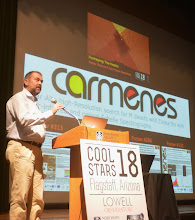 """Photo: Andreas Quirrenbach during the Poster Pop-up of the CARMENES posters at """"Cool Star 18"""" #cs18 - In the Splinter session. """"Portraying The Hosts: Stellar Science From Planet Searches""""."""