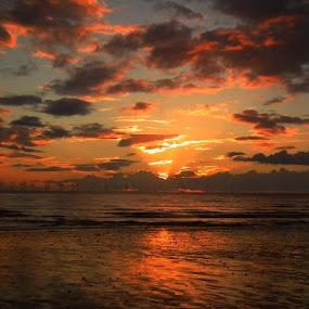 by Paul Rayney - Landscapes Sunsets & Sunrises ( clouds, orange, sand, warm, cumbria, turbine, green, sea, beach, sky, morecambe bay, scene, wind farm, energy )
