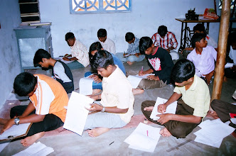 Photo: Children writing their examination at our rural Community Technology centre