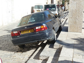 Photo: Limited space leads to creative parking sometimes... (No, this wasn't one of our cars.) :-)