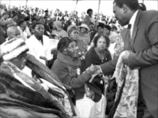 REMEMBER: Mafosi Ntenza, 88, and Eveline Ncemu are among the few survivors of the group of 500 women who marched to the magistrate's court in Ixopo in 1959 to protest against pass laws and labour conditions. Finance and economic development MEC Zweli Mkhize gave them blankets. © Sowetan.
