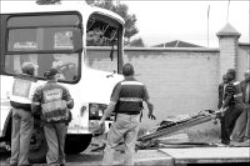 HORROR: Two women were killed and about 50 pupils injured in this bus accident. Pic. Lucky Nxumalo. 09/10/07. © Sowetan.