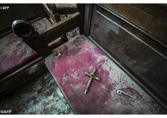 bloodshed and damage following a bomb explosion at the Saints Peter and Paul Coptic Orthodox Church in Cair - AFP