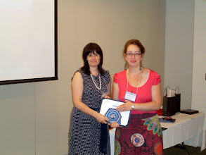 Photo: DRC Isabelle Lavoie awarded PAOE High Honor Roll, Star, & Special Citation to Montreal Chapter, here received by Montreal PP Caroline Paquet