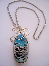 "Photo: Special bead. wires and silver chain 22"". the bead size: 1"" x 2"" $69.00"