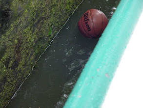 "Photo: We float past a Canal-side basketball court, with this errant ball serving as an unintended bumper. However, all I can think of is Tom Hanks in Cast Away: ""Wilson!"""