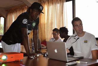 Photo: Tom Legg (performance analyst) provides Mohamed 'Poborsky' Bangura with pre game Performa Sports tactical analysis [Leone Stars Vs. Equatorial Guinea, 7 Sept 2013 (Pic: Darren McKinstry)]