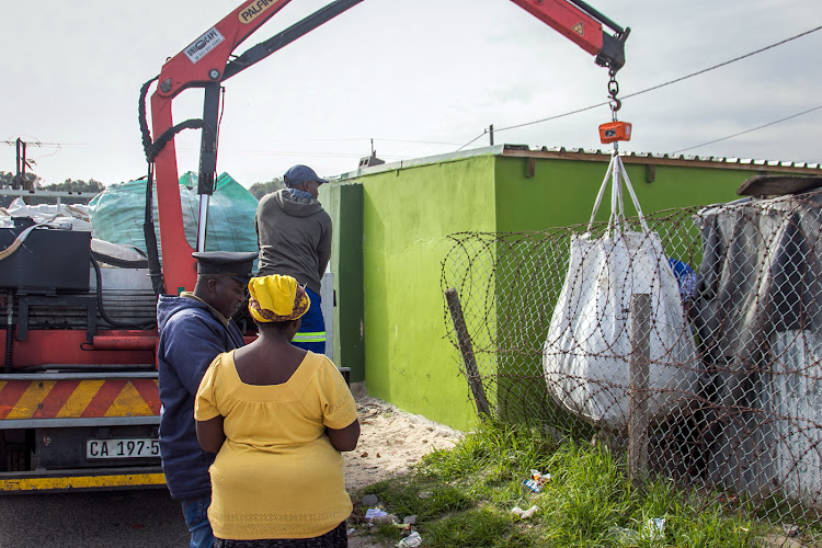 Blue Sky Recycling company aids waste pickers by collecting their materials and paying them by the kilogram for the waste.