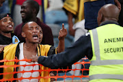 A Kaizer Chiefs fan in a confrontation with a security officer at Moses Mabhida Stadium in Durban on April 21 2018.