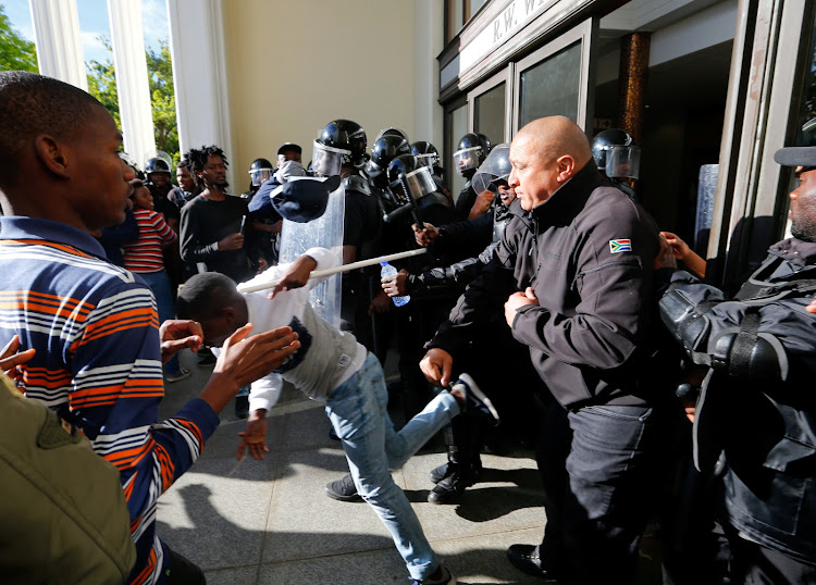 Protestors clash with security at Stellenbosch University. Picture: REUTERS