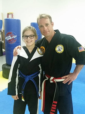Owner John Bowersox with student at karate class in Staunton Va
