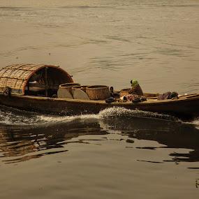 Going by Kaniz Khan - Transportation Boats ( transpportation, transport, movement, vehicle, boat, river,  )