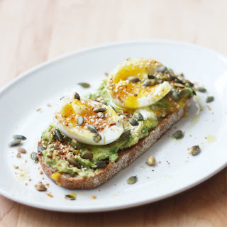 Smashed Avocado, Soft-Boiled Egg, and Pumpkin Seed Tartines