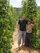 Photo: Mick and our cheerful guide in a pepper plantation