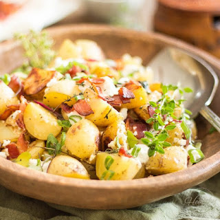 Warm Potato Salad with Creamy Goat Cheese and Crispy Bacon.