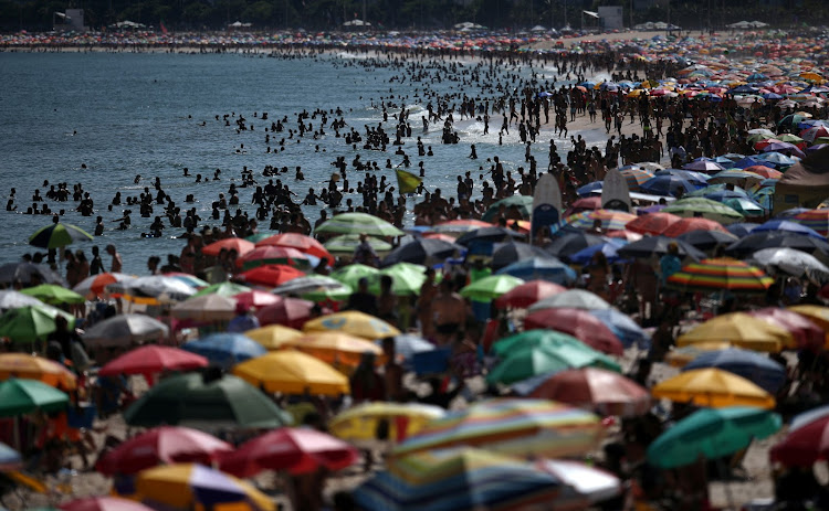 People gather on Ipanema beach after authorities announced measures on the coronavirus outbreak, in Rio de Janeiro, Brazil, on March 15 2020.