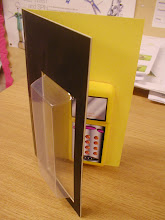 Photo: Year 10 Graphics task. A modelled mobile phone and hinged packaging. Still incomplete.