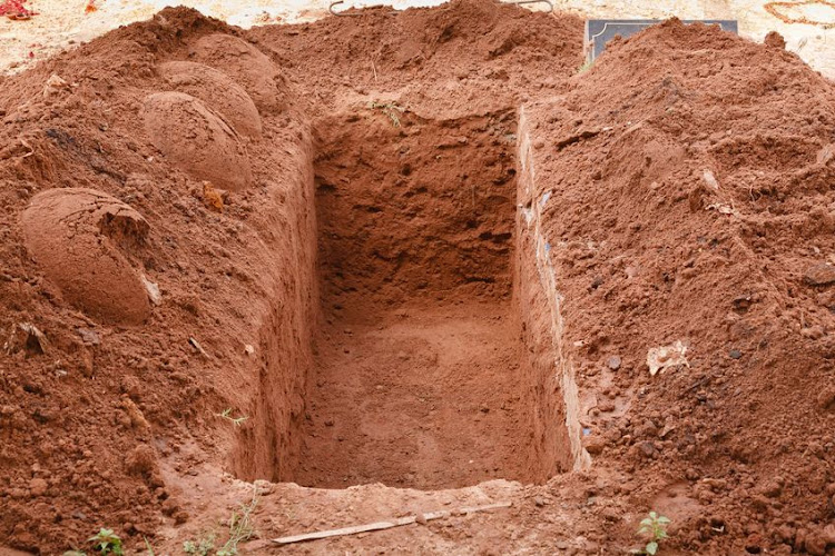Police uncover a grave containing at least 200 bodies.