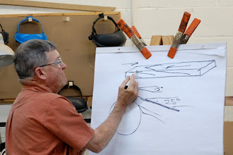 Photo: Ernie showed off his drawing skills as he explained how to cut with the grain and how the angle helps the cut.