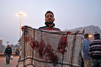 Photo: A bloody Keffiyeh belonging to Mohamad Mustafa Hussan, 24, reported to be in the hospital in critical condition.