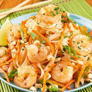 Shrimp Pad Thai with carrots, roasted peanuts, and cilantro