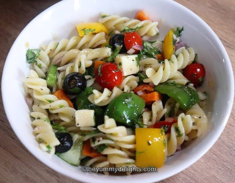 pasta salad served in a white bowl