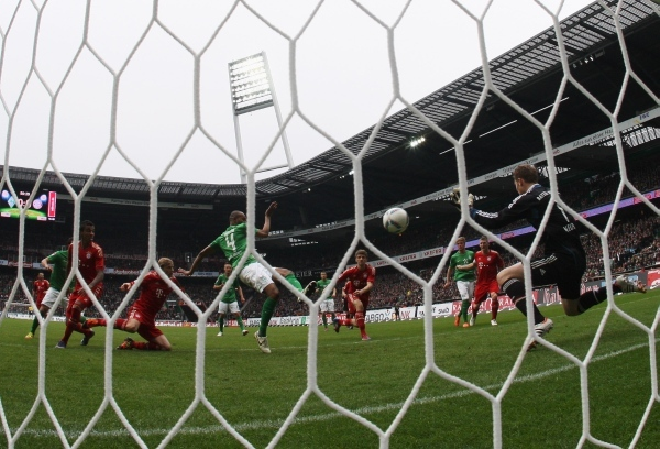 Photo: BREMEN, GERMANY - APRIL 21:  Naldo (C) of Bremen scores his team's first goal during the Bundesliga match between SV Werder Bremen and FC Bayern Muenchen at Weser Stadium on April 21, 2012 in Bremen, Germany.  (Photo by Joern Pollex/Bongarts/Getty Images)