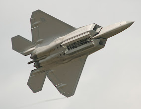 Photo: The F-22 opens its internal weapon bay.