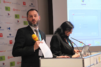 "Photo: Philippe Borremans - moderator, Roma Balwani - presenting: ""Chief Comms Officer's Role"" Panel - 2012"