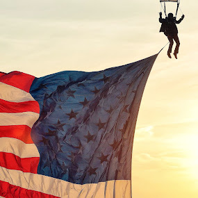 Patriotic skydive by Martin Wheeler - People Professional People ( america flag sunset silhouette skydive parachute yellow )