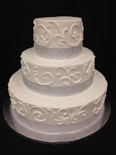 Photo: Elegant 3-tier wedding cake featuring a fancy border and silver diamond wrap around bottom of each tier. No borders. Classy and clean for any kind of wedding.