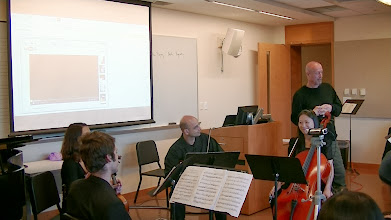 Photo: Composer John McDonald, Chief of the Music Department at Tufts University, speaks of long-term connections between the Educational Bridge Project and Tufts