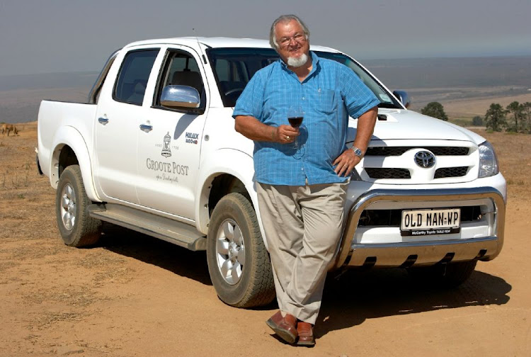 "Groote Post's Peter Pentz with a glass of his favourite Old Man's Blend and his ""Old Man"" bakkie."