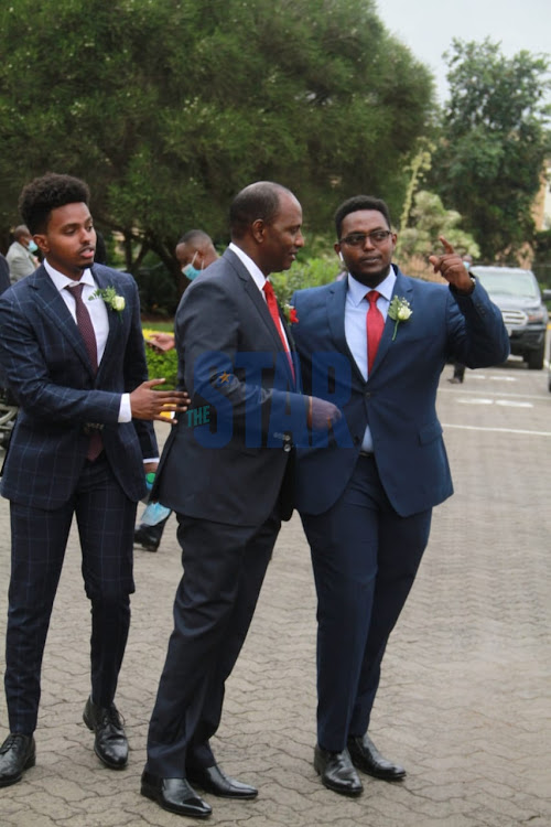 Treasury CS Ukuru Yatani with his two sons Ali and Ibrae outside Parliament on June 11, 2020.
