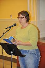 Photo: H. R. Stahl reads her poem.
