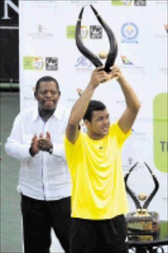 TENNIS KING: Jo-Wilfriend Tsonga of France with the trophy he won during the SA Tennis Open Singles Final against South African Jeremy Chardy which was played at Montecasino in Johannesburg.  08/02/09. Pic. Lee Warren. © Gallo Images.