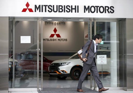 A man walks out from Mitsubishi Motors's showroom at its headquarters in Tokyo, Japan. Picture: REUTERS/TORU HANAI