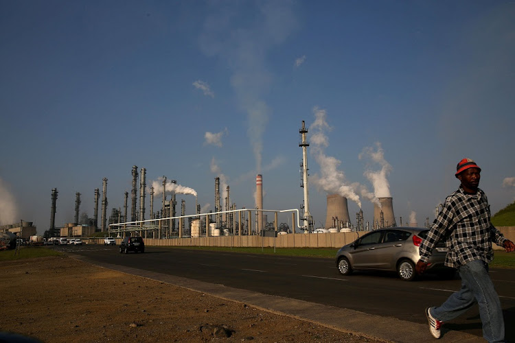 A man walks past a Sasol synthetic fuel plant. Picture: REUTERS