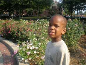 Photo: Q in front of the rose garden