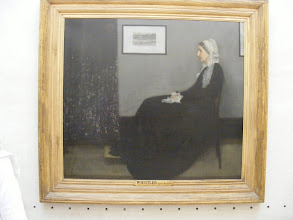 """Photo: Whistler's Mother has moved up from the first floor since our last visit. From the Orsay Web site: Although an American by nationality, Whistler divided his career between London and Paris. He enrolled in Charles Gleyre's studio at the Ecole des Beaux-Arts in 1856 and went into partnership two years later with Alphonse Legros and Fantin-Latour to ensure a better circulation of his works. Fantin-Latour put him in the centre of his painting """"Homage to Delacroix,"""" alongside Manet and Baudelaire, proclaiming his place in the avant-garde of the Paris art world. Whistler was also close to Courbet who briefly considered him """"his pupil"""". """"Arrangement in Grey and Black No. 1,"""" also called """"Portrait of the Artist's Mother,"""" is a reminder, if only through its double title, of the stylization to which Whistler soon submitted the realistic aesthetic of his early years. The portrait's psychological acuity is powerfully conveyed by the deliberately pared down composition. The work, in its linear austerity and chromatic rigor dominated by neutral tones, was a continuation of Whistler's experimentation with prints, to which """"View of the Thames"""" hanging on the wall is an allusion. Dropping all pretense at anecdote, Whistler soon gave nothing but musical subtitles to his paintings, insisting on the musical notion of harmony rather than that of subject matter. The painting, bought by the French state in 1891, is now one of the most famous works by an American artist outside the United States."""