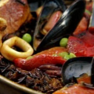Paella With Wild Rice, Seafood & Cornish Hen.