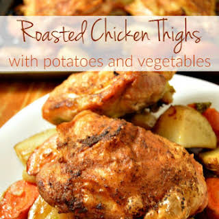 Roasted Chicken Thighs with Potatoes and Vegetables.