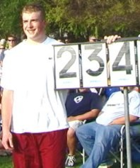 Nik Arrhenius poses with the board after his 2001 discus national record at Arcadia. Photo by John Dye.