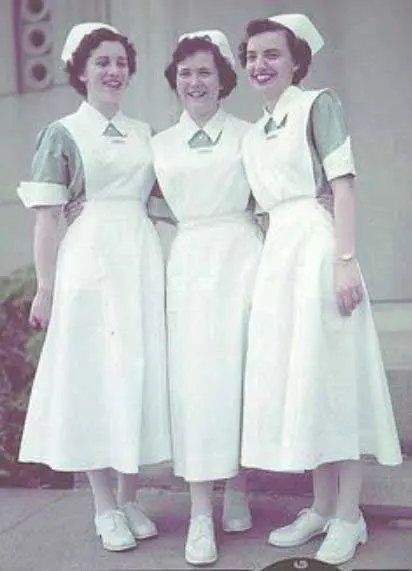 Three nurses smiling while standing with each other in ancient times