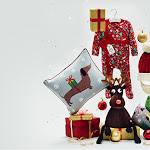 A range of Christmas products, including a red festive baby onesie, a Santa hat and a cushion, surrounded by confetti and presents