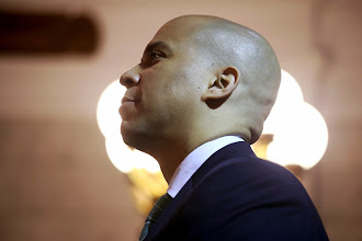 Photo: NEWARK, NJ - MAY 08:  Newark Mayor Cory Booker stands for the presentation of the colors at the Newark City Hall on May 8, 2013 in Newark, New Jersey. Booker, who has declared that he will run for New Jersey's open U.S. Senate seat in 2014, was attending a ceremony honoring 90-year-old WWII veteran Willie Wilkins on the 68th anniversary of Victory in Europe Day.  (Photo by John Moore/Getty Images)