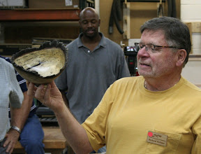 Photo: And now for the Show & Tell!  ...  Richard Webster talks about the black lines and dots in his persimmon natural-edge bowl with beautifully-retained bark.